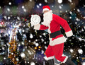 man in costume of santa claus with clock - PhotoDune Item for Sale