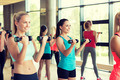 group of women with dumbbells in gym - PhotoDune Item for Sale