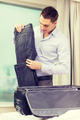 businessman packing things in suitcase - PhotoDune Item for Sale