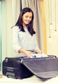 businesswoman packing things in suitcase - PhotoDune Item for Sale