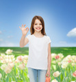 smiling little girl in white blank t-shirt - PhotoDune Item for Sale