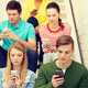 busy students with smartphones sitting on stairs - PhotoDune Item for Sale