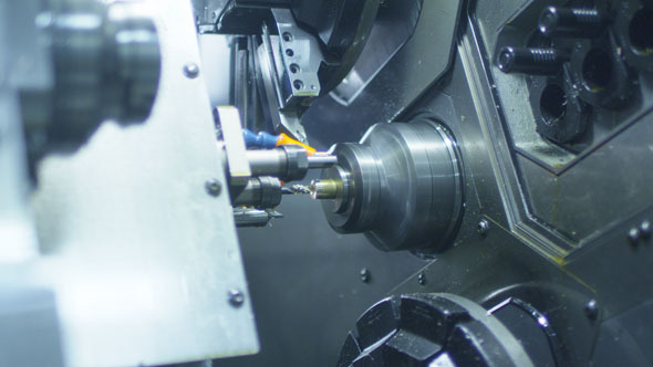 CNC Lathe Produces Metal Detail on Factory 4