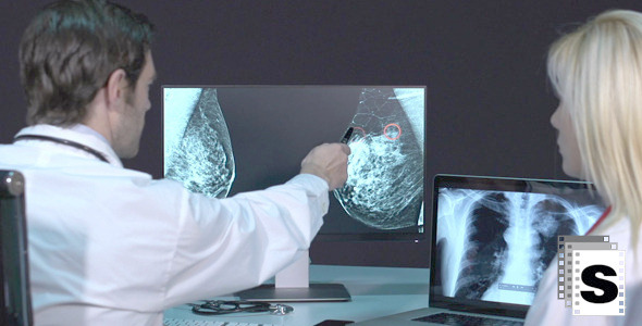 Doctors Analyzing Mastography X-ray