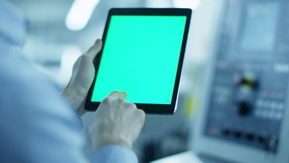 Worker is Using Tablet PC with Green Screen