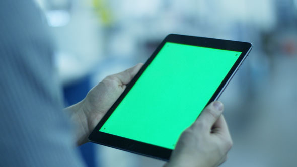Worker Holding Tablet PC with Green Screen