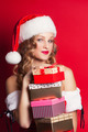 beautiful young woman wearing Santa Claus costume holding colorf - PhotoDune Item for Sale