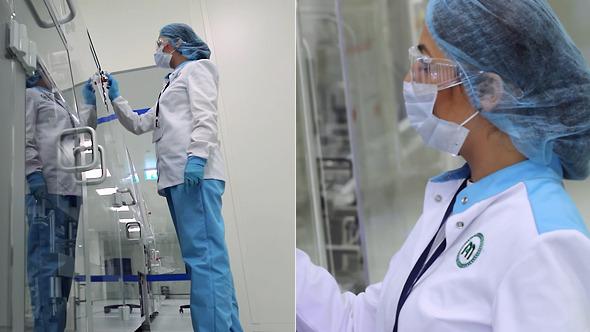 Woman Controls Machine at Modern Drug Factory