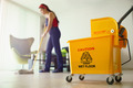 Woman Doing Chores Cleaning Floor At Home Focus on Bucket - PhotoDune Item for Sale