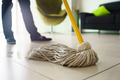 Woman Doing Chores Cleaning Floor At Home Focus on Mop - PhotoDune Item for Sale