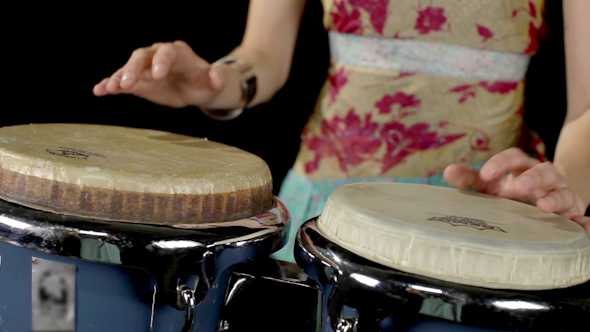 Female Percussion Drummer Performing With Bongos 2