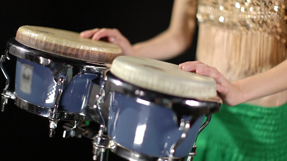 Female Percussion Drummer Performing With Bongos 3
