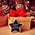 gifts and text happy holidays in a star-shaped chalkboard - PhotoDune Item for Sale