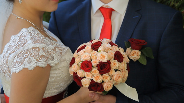 Newlyweds and Wedding Bouquet