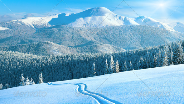 Winter mountain panorama with ski track - Stock Photo - Images