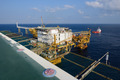 The offshore oil rig and supply boat in the gulf of Thailand