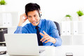 smiling businessman wearing a headset at the office - PhotoDune Item for Sale