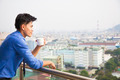relaxed businessman watching the city view - PhotoDune Item for Sale