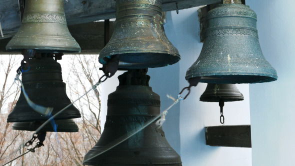 Bell Ringer Plays Church Bells at Belfry