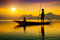 Beautiful sky and Silhouettes of fisherman at the lake, Thailand - PhotoDune Item for Sale
