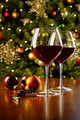 Glasses of red wine on table with Christmas tree - PhotoDune Item for Sale