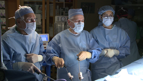 Group Of Surgeons Performing Surgery 8 Of 15