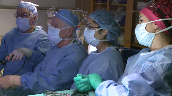 Team Of Surgeons Performing Surgery 14 Of 15