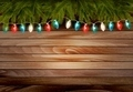 Christmas wooden background with branches and a garland.  - PhotoDune Item for Sale