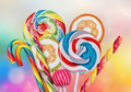Colorful candies and sweets on a multi-colored background - PhotoDune Item for Sale