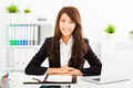 smiling young business woman working in the office - PhotoDune Item for Sale