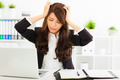 stressed  businesswoman sitting in office - PhotoDune Item for Sale