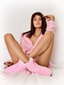 Beautiful woman in pink cosy sleepwear on the bed. - PhotoDune Item for Sale