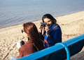 Two girls take pictures on the beach with an old camera - PhotoDune Item for Sale