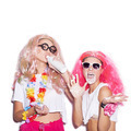 Funny girls in colored wigs and glasses stained with cream - PhotoDune Item for Sale
