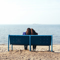 Two slender girl relaxing on shore of sea on evening - PhotoDune Item for Sale
