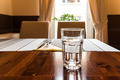 Glass Of Water On Restaurant Table - PhotoDune Item for Sale