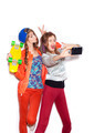 Two young sporty girls have fun together.  Beautiful women making selfie - PhotoDune Item for Sale