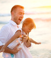 Young Happy Father having fun with his Little Daughter outdoors - PhotoDune Item for Sale