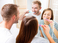 Young couple in the bathroom brushing teeth together - PhotoDune Item for Sale
