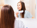 Beautiful girl is combing her long silky hair in the morning - PhotoDune Item for Sale