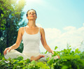 Young woman doing yoga exercises outdoors - PhotoDune Item for Sale