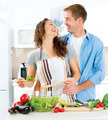 Man and Woman in their Kitchen Preparing Vegetable Salad - PhotoDune Item for Sale
