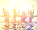 Group of happy teen girls playing at the beach on sunset - PhotoDune Item for Sale
