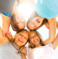 Group of teen girls having fun outdoors over blue sky - PhotoDune Item for Sale