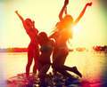 Beach party. Teenage girls having fun in water - PhotoDune Item for Sale