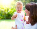 Beautiful mother and baby playing in a park - PhotoDune Item for Sale
