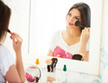 Beautiful girl looking in the mirror and applying cosmetic - PhotoDune Item for Sale