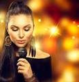 Singing Woman with Microphone over Blinking Background - PhotoDune Item for Sale