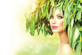 Girl with green leaves on her head. Beauty summer woman portrait - PhotoDune Item for Sale