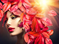 Autumn Woman. Fall. Girl with colourful autumn leaves hairstyle - PhotoDune Item for Sale